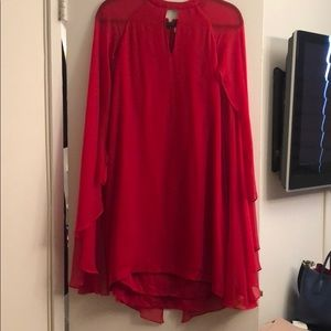 Red Parker cocktail dress with attached cape